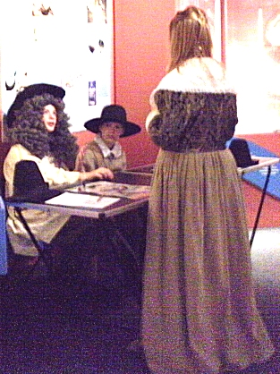 This is an animated photo with various photos from around the museum, such as staff dressed up on Roman and Civil War days, kids learning while sitting at a table, an old postcard of Staines back in the early 1900's, the entrance to the Museum with the pillars, the ancient head being shown by staff members, the London Stone, the old fire engine, the Mayor of Stanwell, bottles from Ashby's, souvenier items from Spelthorne, and windows on Spelthorne